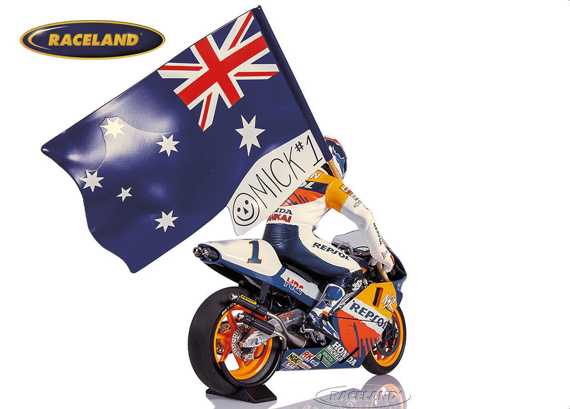 Honda NSR 500 Team Repsol 1995 World Champion Mick Doohan figure with flag on out lap Image 2